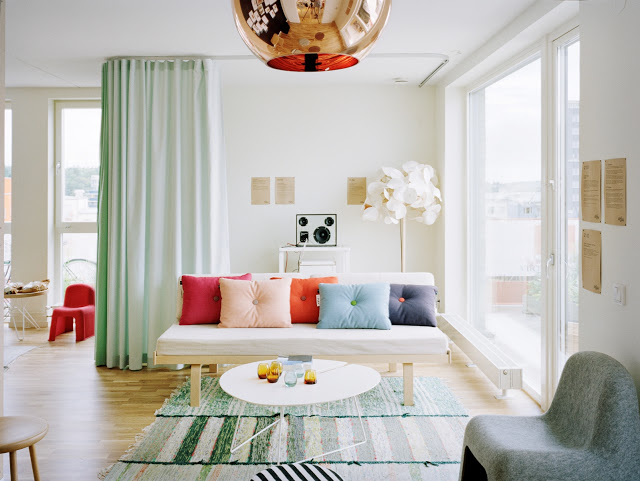 living room mint green drapery drapes curtain copper tom dixon pendant stripe striped rugs carpeting flooring floor colorful sofa cococozy